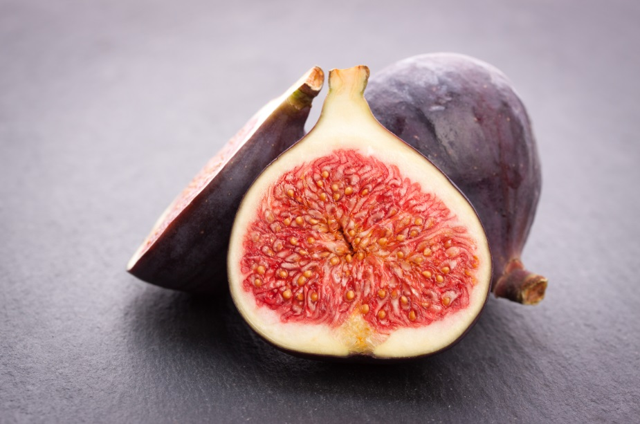 Fresh figs on black stone background